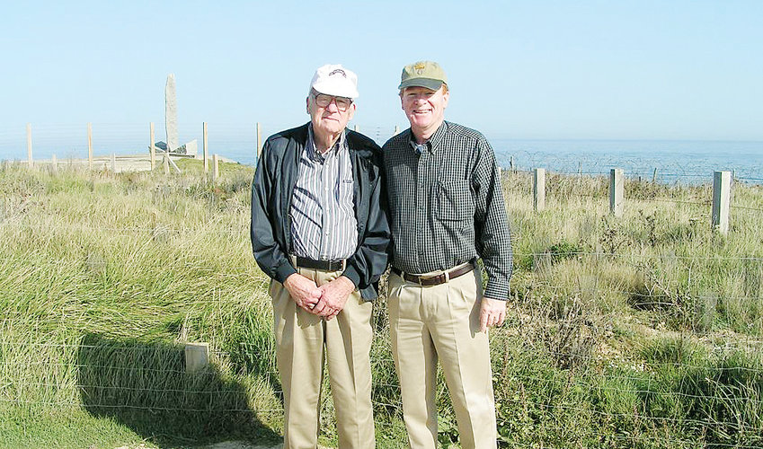 James B. Hudnell, left, returned to Normandy in 2006, more than 50 years after his ill-fated attempt to land on the beach during D-Day. His son, Rod Hudnell, right, is leading an effort to have the Ranger units his father was a member of recognized for their contributions to the Allied war effort.