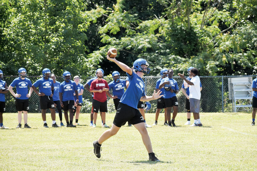 Kelly Snow | The Courier-Times.Person quarterback Ridge Clayton fires a pass during Thursday's 7-on-7 scrimmage against Bartlett Yancey while teammates look on..