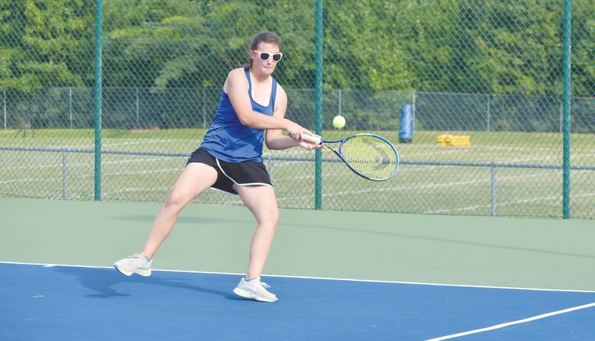 Kelly Snow | The Courier-Times.Person's Julie Taylor takes a swing at a backhand during Monday's season-opening match against Roxboro Community School.