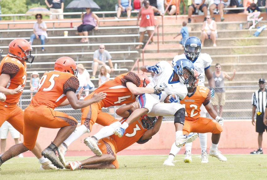 Kelly Snow | The Courier-Times.Person football player Kentrayle Holloway tries to work his way through traffic during the team's scrimmage against Orange. The Rockets will open the season Friday at home against Jordan.