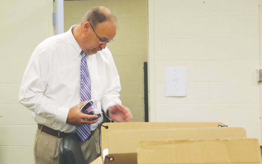 Person County Schools Superintendent Rodney Peterson checks out supplies bound for a local school from the system's central office.