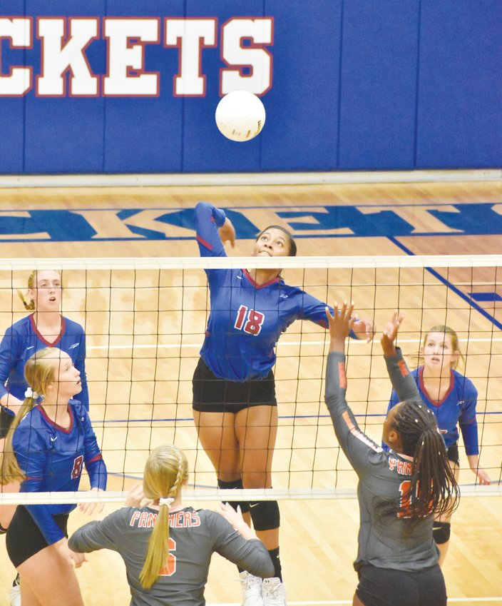 Kelly Snow | The Courier-Times.Person's Aaliyah Jones gets a clean look at a quick set during the second set of Wednesday's match against Orange.