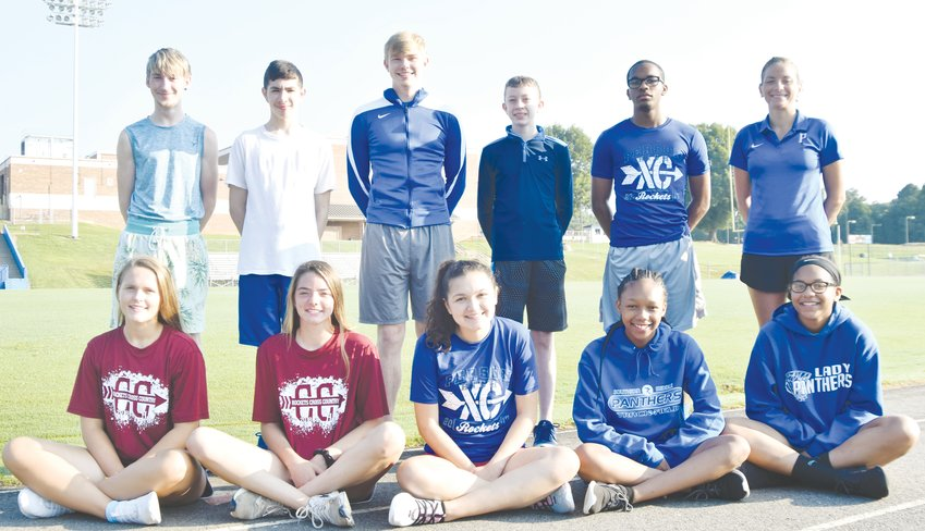 Members of the Person High School cross country team include: front row (left-to-right) Maggie Holeman, Taylor Sullivan, Neya Garcia, Terika Gentry, Kayla Brown. Back row: volunteer assistant coach Logan Bates, Daniel Smith, Cameron Whitman, David Smith, Demetre Morton, coach Morgan Meyer. Not pictured: Will Bailey, Paul Bailey, Colton Fox, Allen Arthur, Payne Garrett, Aiden Allen, Peyton Price.