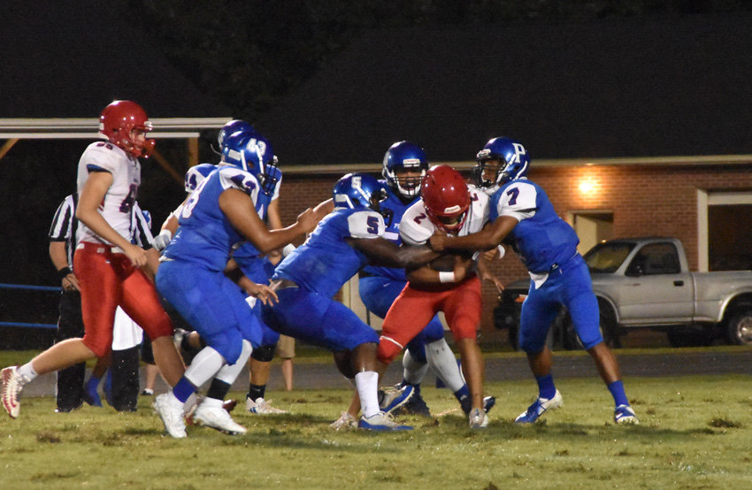 Person football players Kentrayle Holloway (7), Dre Newman (5) lead a group of tacklers on Jordan running back Andrew Hayes during Friday's season opener.