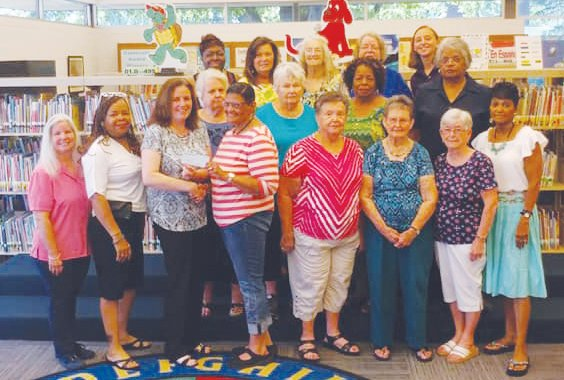 ECA members presented a donation of $1,000 to the Person County Library for their bookmobile. ECA members present include, front row, from left, Rhonda Haynes, Louise Oliver, Library Director Christy Bondy, Corlis Green, Joan Long, Dorothy Coates, Betty Jean Mangum, Charlene Wilkins; second row: Olivia Bottoms, JoAnn Howerton, Dorothy Wagstaff, Nannie Smith; third row: Linda Bailey, Lori Browning, Foy Harrell, Kathy Howell, and Family Consumer Sciences Extension Agent Jennifer Grable.