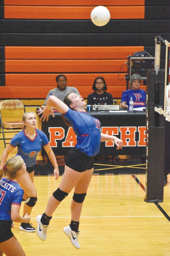 Kelly Snow | The Courier-Times.Person's Blair Nance lines up a big swing during the JV Rockets' match Wednesday at Orange.