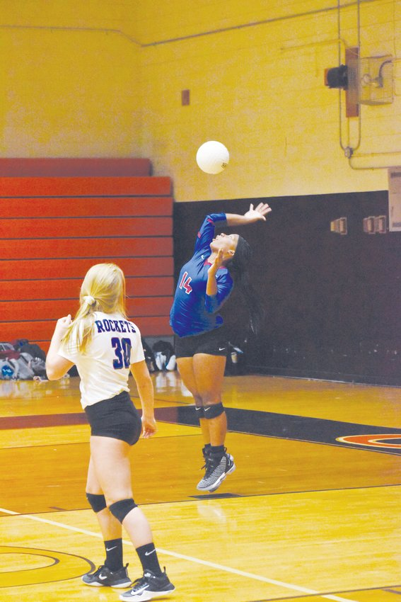 Kelly Snow | The Courier-Times.Person's Jakeya Paylor came off the bench and delivered three consecutive aces to help lead to Rockets to a victory in the second set at Orange.