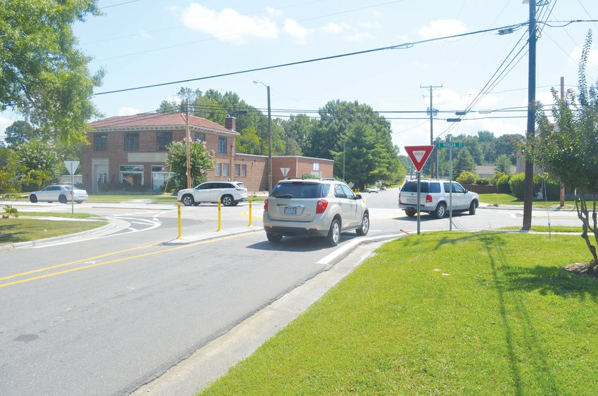 Cars operate the roundabout at the intersection of Couth Morgan Street and Long Avenue Tuesday.