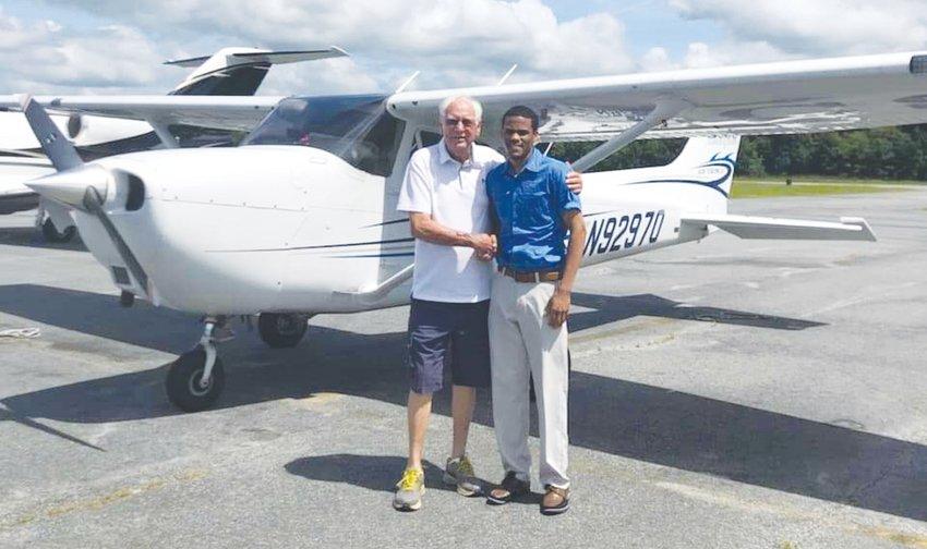 Reginald Thomas, right, with his flight instruction intsructor Henry Joyner. Thomas became the first person to earn his flight instructor's certificate at Elizabeth City State University.