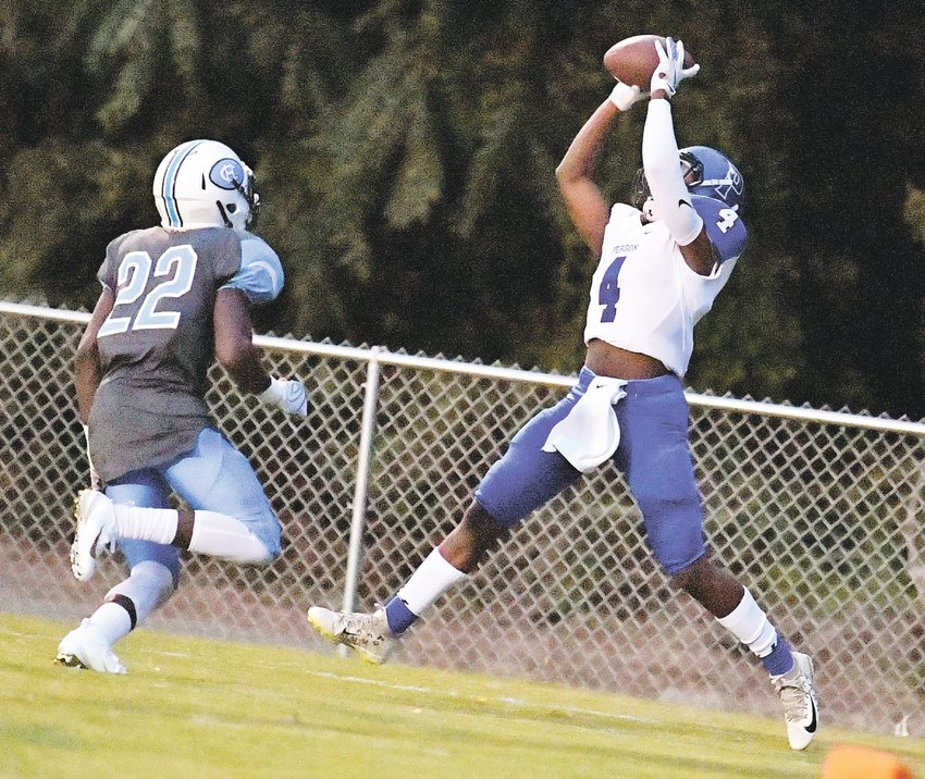 Person High School receiver Trey Lunsford (4) makes a leaping catch of a pass from Rockets quarterback Ridge Clayton to score the team's first touchdown in the second quarter of last Friday's game against Halifax County High School. The play was good for 20 yards.