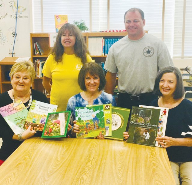 Roxboro Garden Club members, from left, Linda Bridges, Cheryl Allen, Deb Burke presented books to the staff at Southern Elementary School recently. They are pictured with media coordinator Erin Redfern and principal Patrick Holmes..