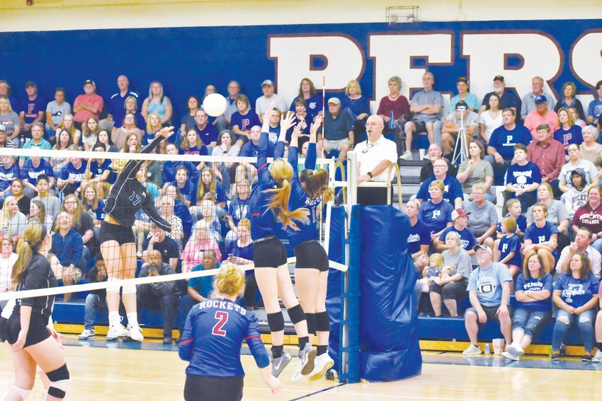 Person defenders Karoline Cox, left, and Madison Dunkley rise to block a shot by a McMichael player.