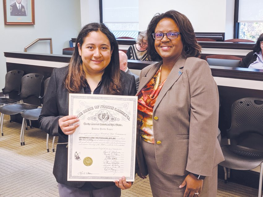 Paulina Lopez, left, was presented to members of the Person County legal community last week by Carolyn J. Thompson.
