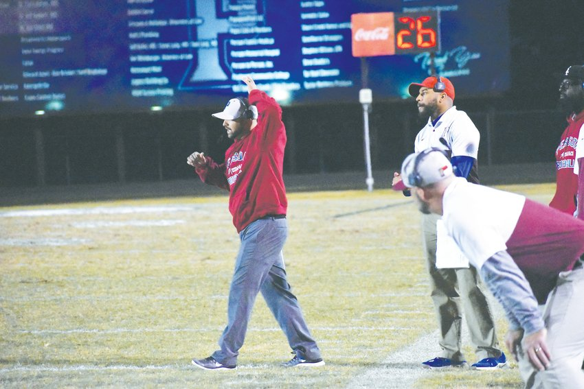 Person football coach Joey Carroll, pictured here during the Rockets' game against Northern Guilford, says he hopes his team's win will create a sense of urgency in his team as they try to finish the season on a strong note as they chase the conference's final playoff spot.