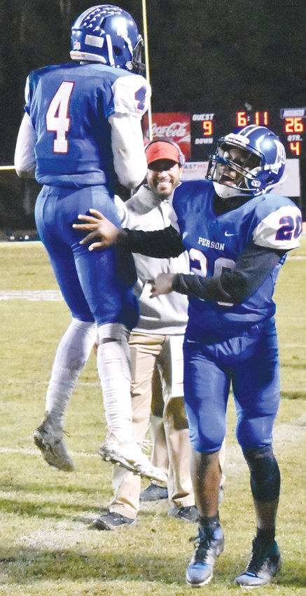 Trey Lunsford (4) and A.J. Terrell (20) celebrate on the sidelines during the fourth quarter of their 26-9 Senior Night victory.