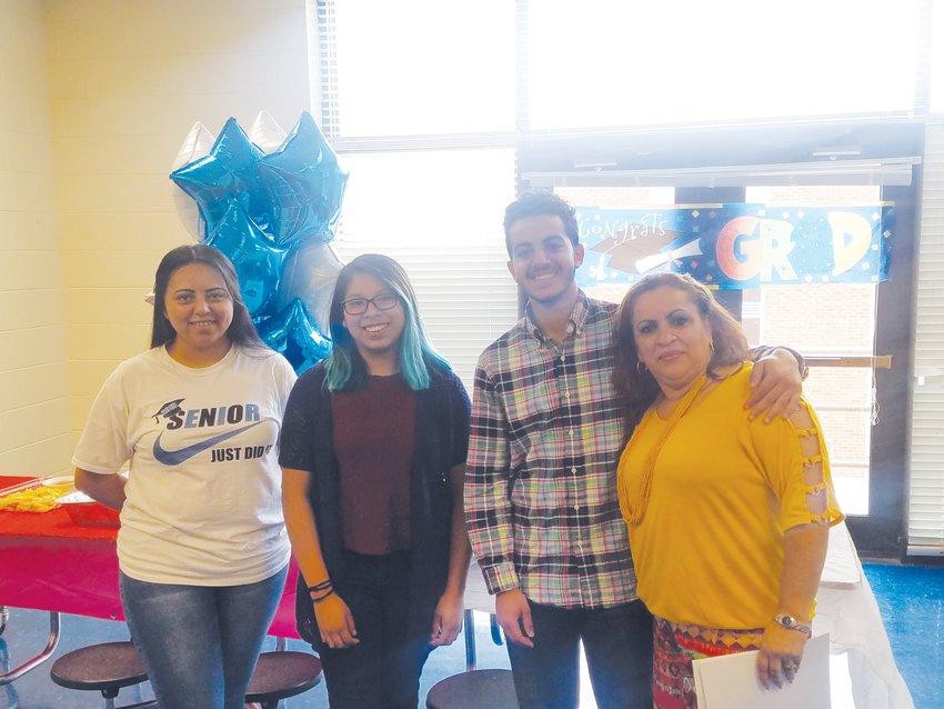 From left, ESL students Diana Rivas, Clarisa Ignacio, Kerollos Hannalla, and teacher Tania Vives. These students graduated in 2019.