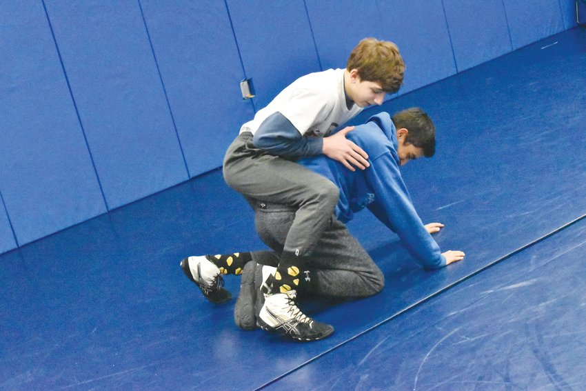 Patrick Anderson (top) and Fabian Rivera (bottom) wrestle during a Rockets wrestling practice.