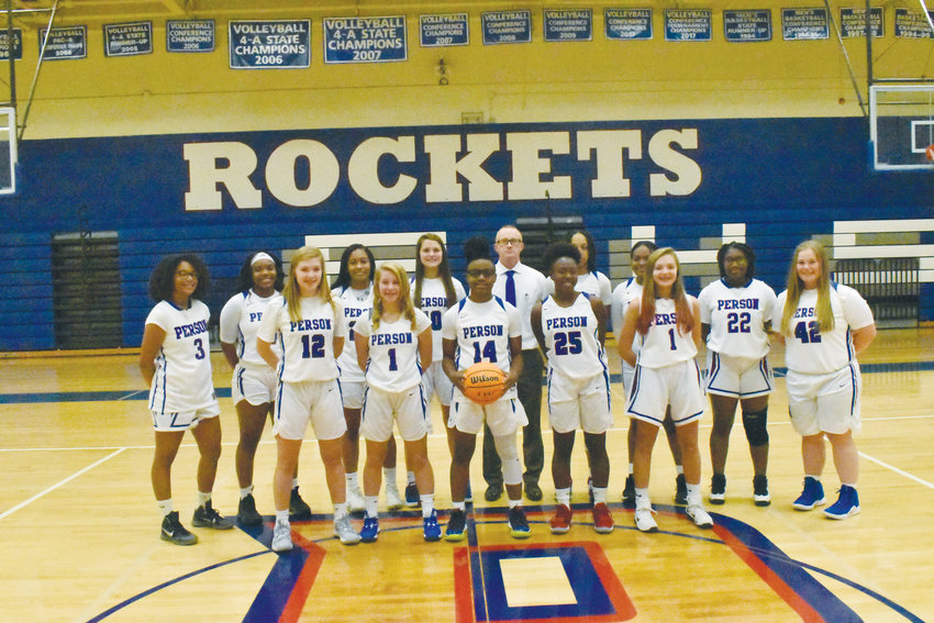 Members of the Person Rockets women's basketball team pose for a team photo before practice at the PHS gynasium.