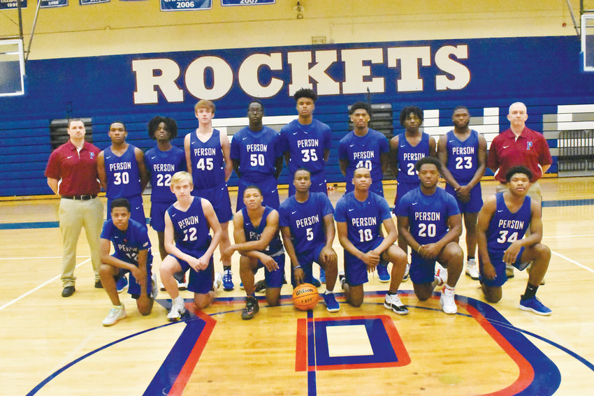 The Person High School men's basketball team poses for a team picture before practice.