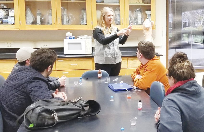 PCC instructor Katie Hester explains a lab process to her Biology students.