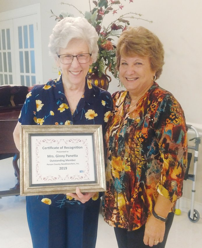 Person County Needleworker of the Year Ginny Pannetta, left, was recognized by the group's president, Joanne Agro.