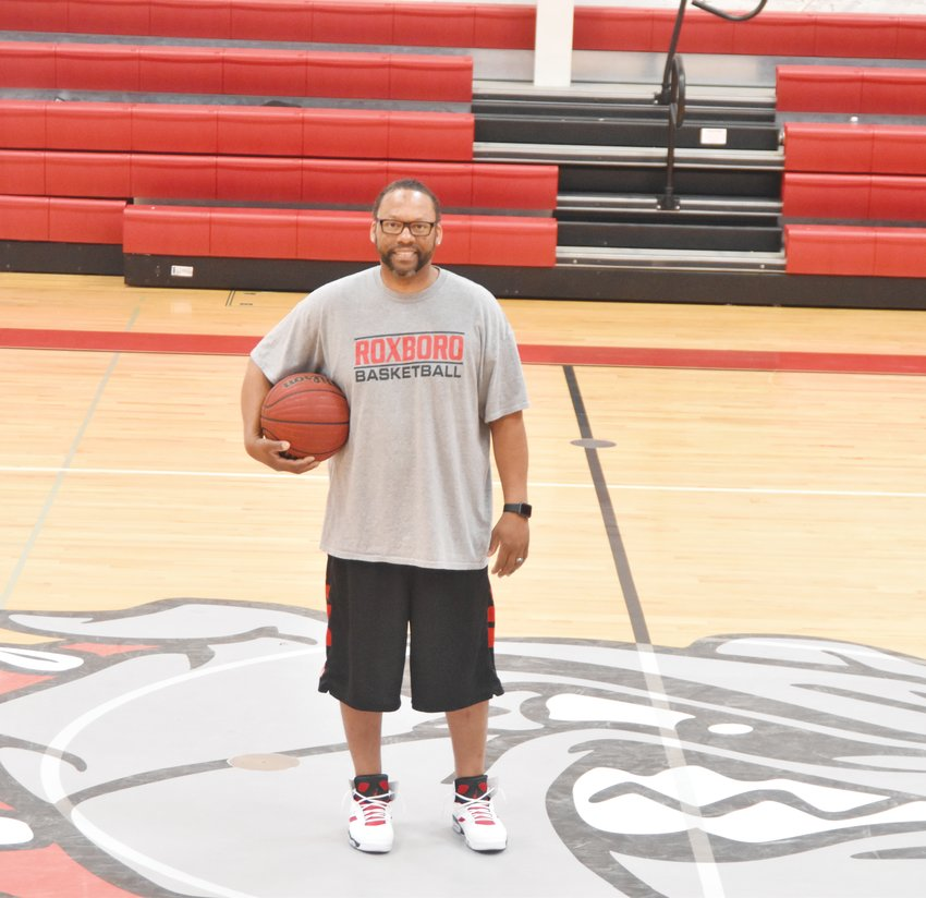 Earl Bailey, RCS women's basketball head coach, poses for a picture in the RCS gym.
