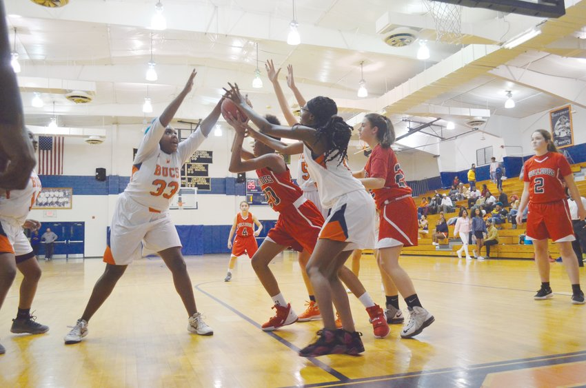 RCS freshman Michiyaj Jay looks for a pass after securing a rebound Wednesday night against Bartlett Yancey.