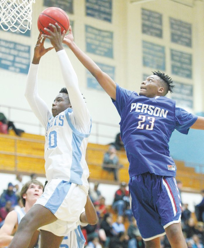 Person High School's Ken Stewart (23) attempts to block a Halifax County layup in last Friday night's matchup against the Comets.