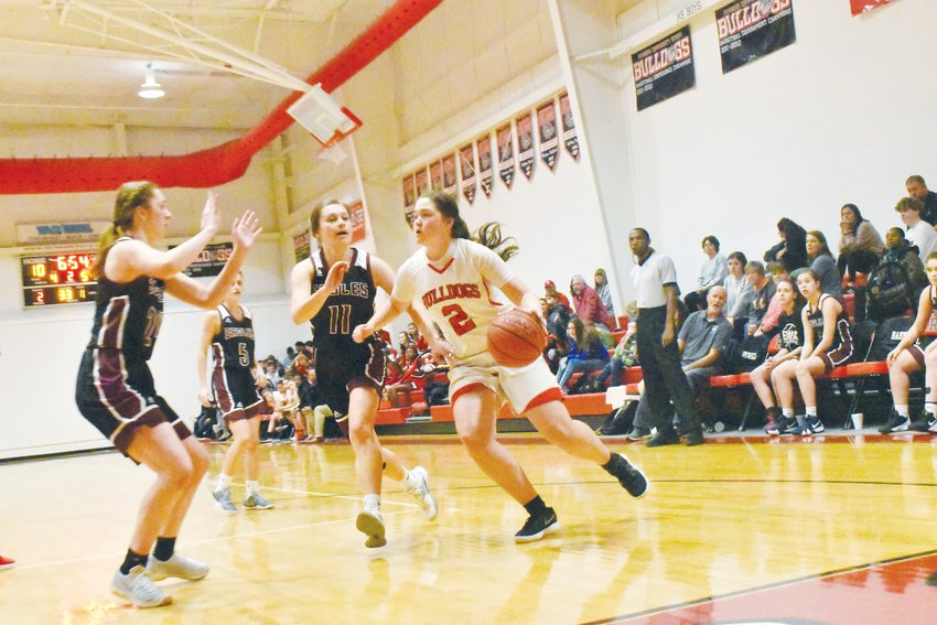 Paige Melton (2) drives to the basket in the second quarter of RCS' Friday night matchup against East Wake Academy.
