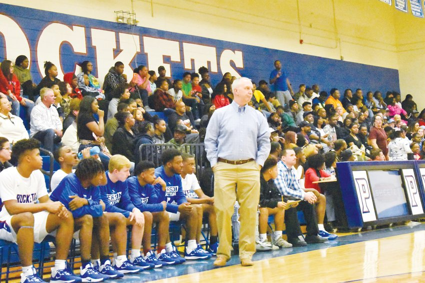 Charles Dacus, head coach of the Person High School men's basketball team, watches his players in a Rockets game earlier this season.