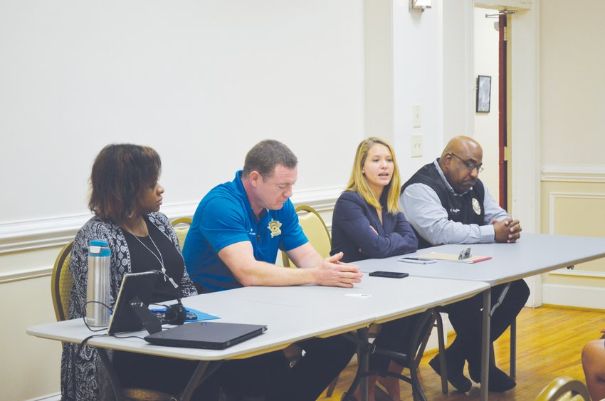 Panelists, from left to right Kiricka Yarbough Smith, Capt. Jason Wilborn, Assistant District Attorney Hollie McAdams and Lt. Ricky Hughes, discuss human trafficking at a human trafficking awareness session hosted by the Guardian ad Litem and Person County Human Trafficking Committee.