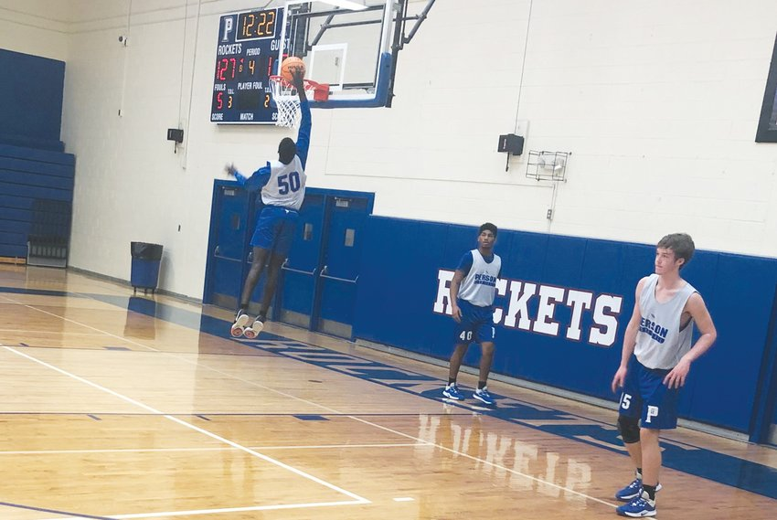 Taco Thompson goes after a dunk in practice during his eighth-grade season.