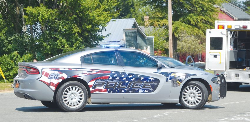 A Roxboro Police Department Dodge Charger sits at the scene of an accident at the intersection of Depot and South Foushee streets.