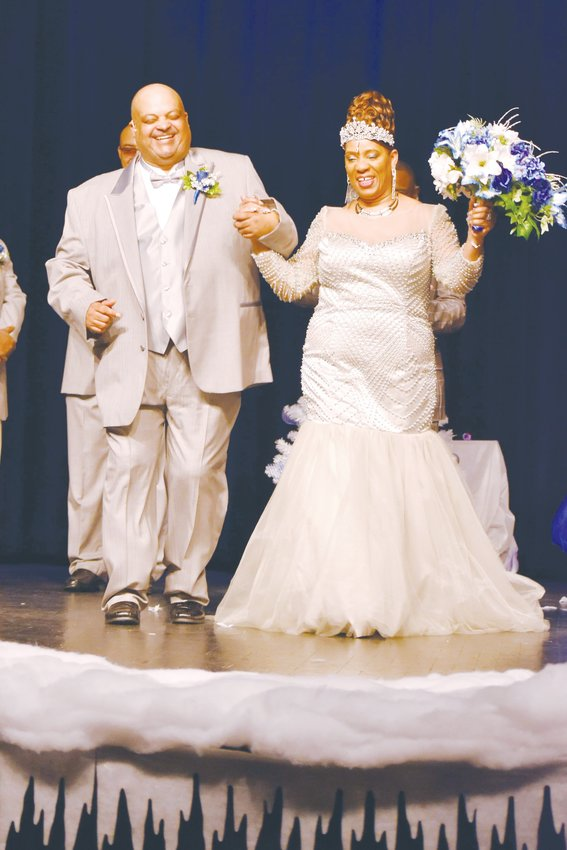 Donald and Jennifer Daye renewed their wedding vows on the stage at the Kirby Theater, becoming the first couple to hold their wedding at the  facility.