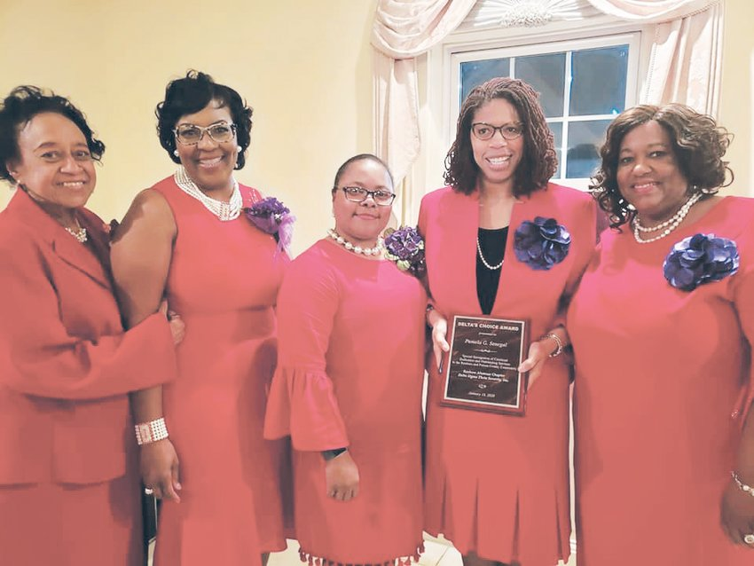 Dr. Pamela Senegal holds her Delta Choice award surrounded by chapter members from left to right:  Jacqueline Booker, Linda King, Michelle Tuck Thomas and Anita Tapp.