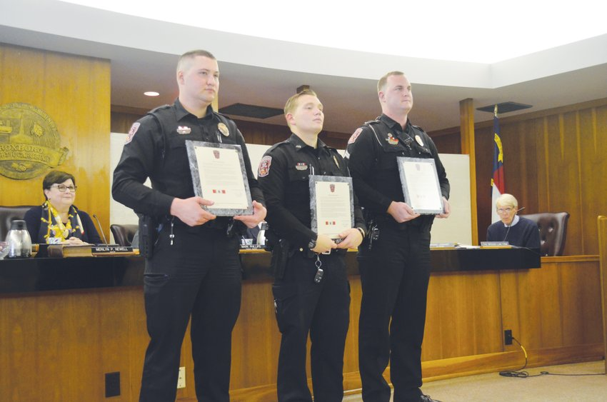 Pictured from left to right: Officer B. A. Warren, J. F. Seifert and Corporal T. S. Gray. The three officers were recognized at Tuesday's Roxboro City Council meeting for their efforts to assist a Roxboro woman with getting milk and food for her child Jan. 18.