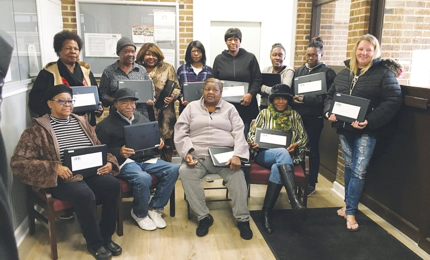 Graduates of the Roxboro Housing Authority's first digitial inclusion program received new laptops at a ceremony last week at Harris Gardens.