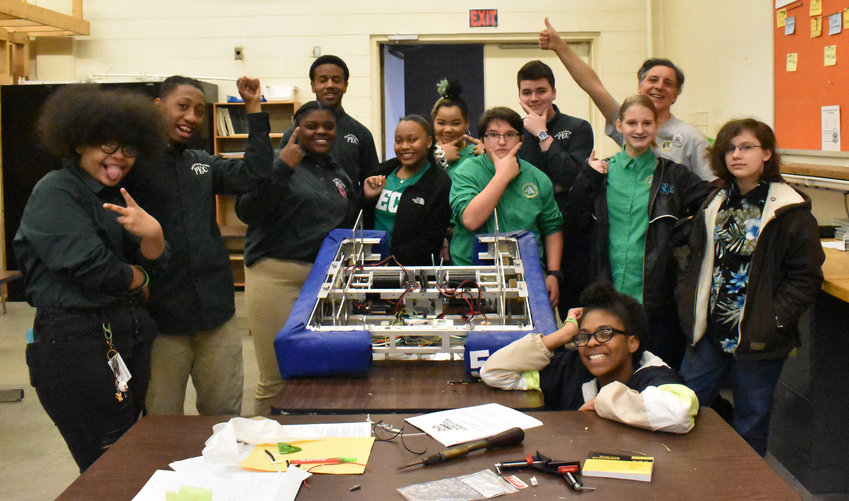 Members of the PECIL Robotics team celebrated a successful first competition. The team won four of its 12 competitions over the weekend in Rolesville, a feat rarely achieved by teams entering their first competition. Pictured above, from left, are Lauren Richardson, Elijah Raines, Brittnee Woody, Zachariah Lunsford, Kania Stewart, Kira Worley, Matthew Ennis, Carson Duncan, Brooke Radcliffe, mentor David Hardt, Cathryn Haymes and Yazmine Williams.