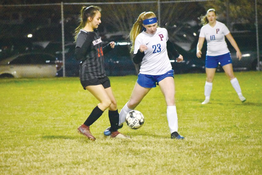 Person High School defender Jordyn Lynch (right) tries to keep the ball away from Roxboro Community School's Mariana Alcaraz in last Friday's cross-town rivalry. Person won 6-0.
