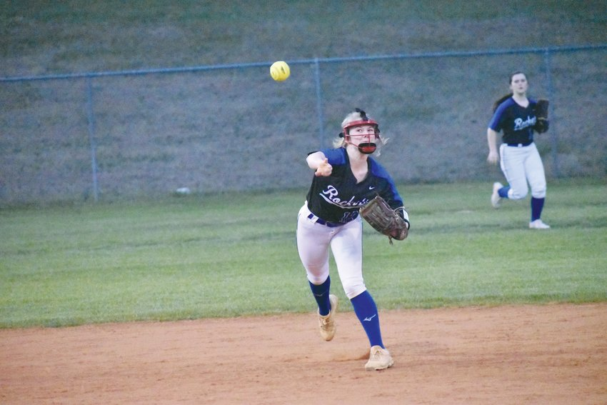 Person's Kelcey Mangum fires a throw to first base in the Lady Rockets' 11-1, Tuesday triumph over Northeast Guilford.