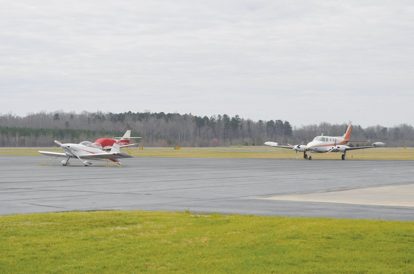 Several planes sit parked at the Person County Airport Monday morning.