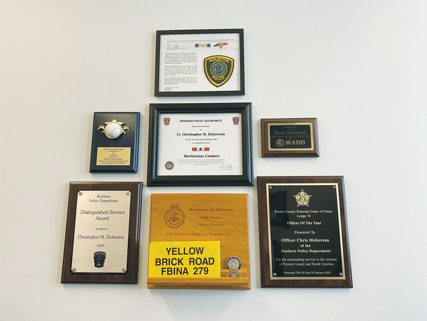 Lt. Chris Dickerson's yellow brick commemorating his completion of the Yellow Brick Road is displayed in his office among other recognitions.