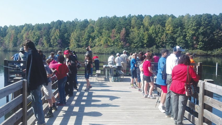 MOLO Fishing Day, taking place on the Mayo Lake fishing pier, is a fishing program for special needs students in Person County Schools.