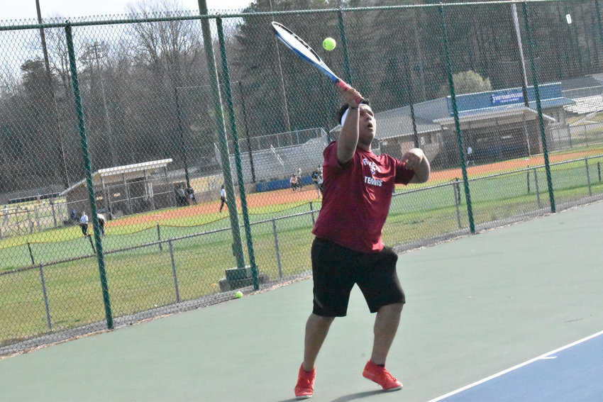 PHS senior Jonathan Osnaya serves it up in his individual match against J.F. Webb's Zach Peeden on March 12. Osnaya is the lone senior departing this year's Rocket tennis team.