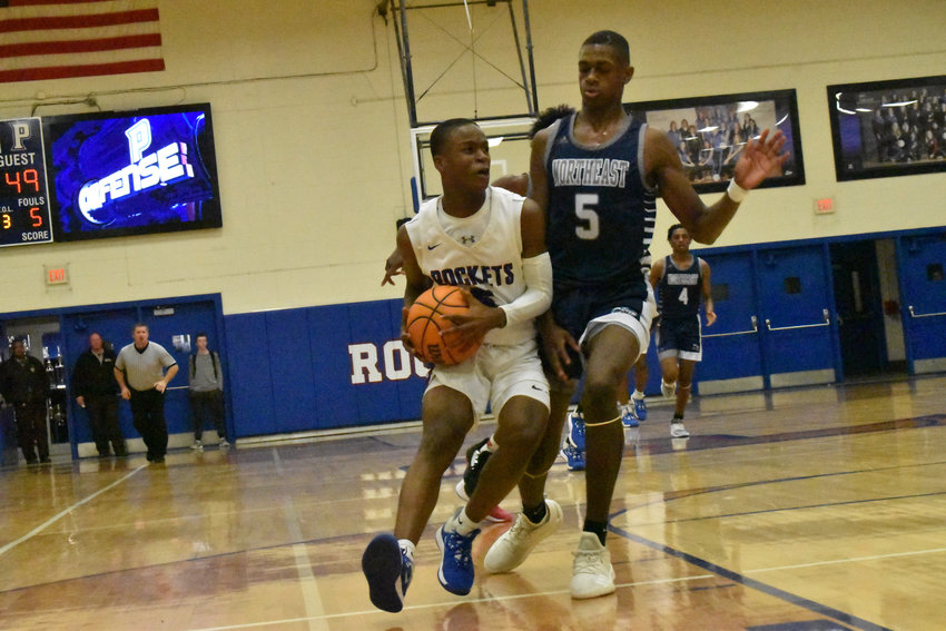 Rocket basketball junior Tae Bailey, left, bodies up Northeast Guilford's Jayden Hall in Person's Feb. 14 Senior Night game. Bailey was a key player in the Rockets' 2019-2020 season, averaging a team leading 16.7 points per game and 5.7 assists per game.