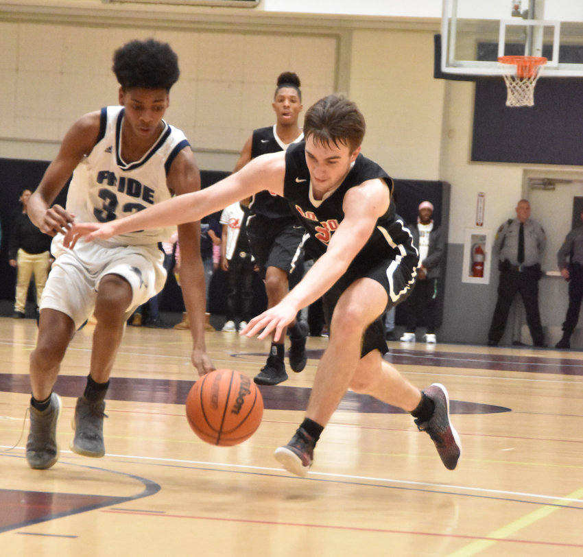 Dylan Jones, a member of RCS' Class of 2019, goes for a steal against Henderson Collegiate in a game during the 2018-2019 season.
