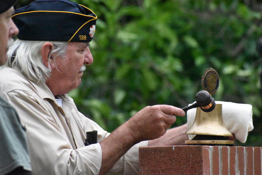 American Legion Post 138 member Ed Hersey rang a bell following the calling of each name of a Person County resident who died in war. Hersey was taking part in a Memorial Day observance Monday at the Veterans Memorial Park in Roxboro.