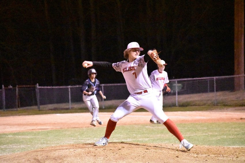 Roxboro Community School pitcher Bryson Pleasant gets ready to deliver a pitch in the Bulldogs' March 4 season opener against Panther Creek. Pleasant is continuing his career at Patrick Henry Community College (VA) in the fall.