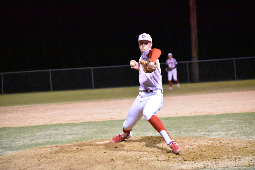 The Bulldogs' William Leonard pitches in Roxboro Community School's March 4, 2020 season opener against Panther Creek. Leonard's workouts consist of traveling to Virginia once a week and training at home. Leonard is playing at Barton College in the fall.