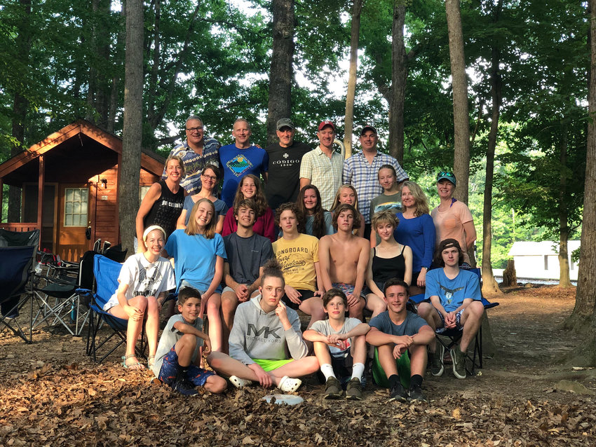 Raleigh resident Stacy Rusak, second from right in the third row, goes to Mayo Lake Park every summer – since 2011 – with family and friends. This year, the virus canceled Rusak's plans.